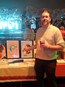 Visual artist Monty Milne displaying two of his art prints